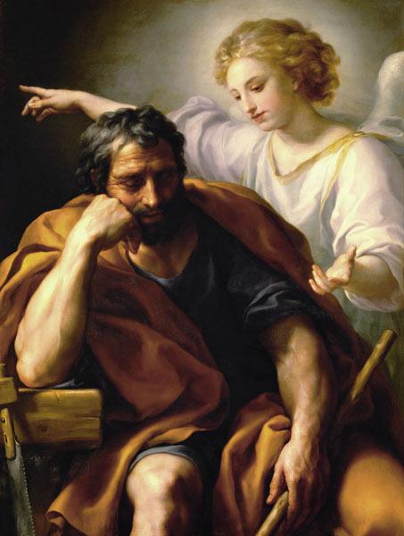 Josef sitzt schlafend auf einem Stuhl. Ein Engel steht hinter ihm und zeigt ein eine andere Richtung.