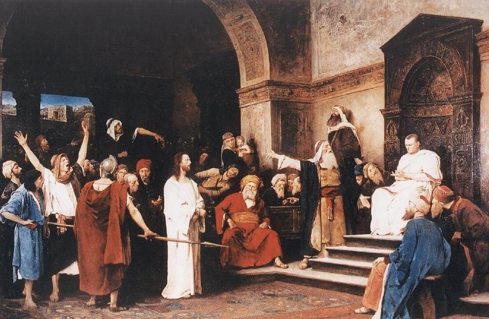 Wir befinden uns in einem Gerichtssaal. Der Richter thront auf seinem Stuhl, das Volk ist aufgebracht, einige zeigen auf Jesus.