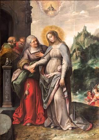 Die schwangere Elisabeth schaut zu Maria auf.  Maria führt ihre Hand und blickt auf Jesus.