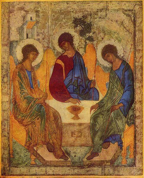 Drei Personen sitzen um einen Tisch. Sie haben Flügel und einen Heiligenschein.